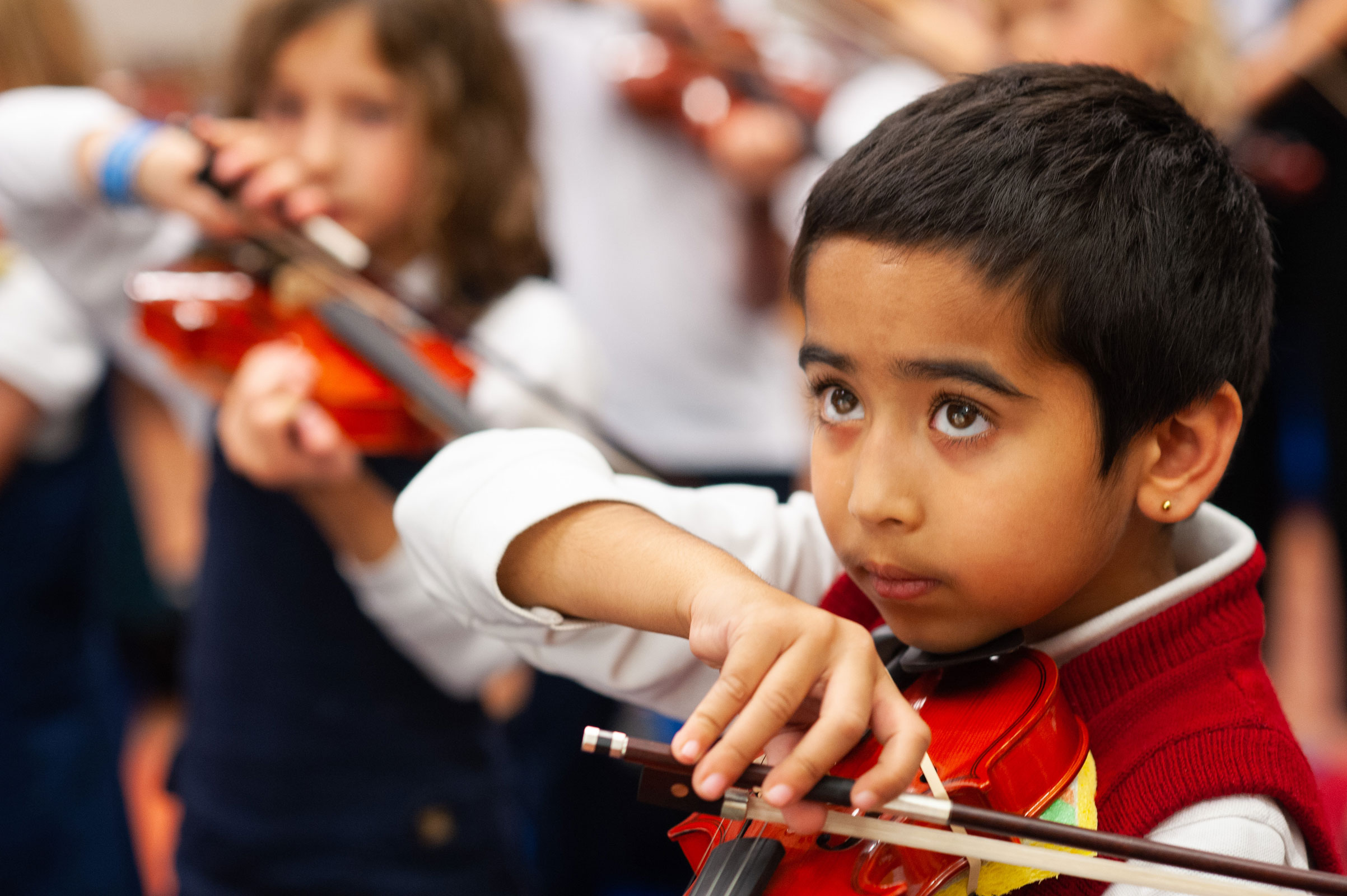 British-School-Editorial-Style-Photography-Closeup-Student-Playing-Violin-in-Class